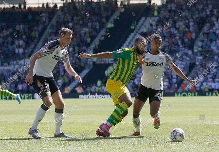 West Bromwich Albion's Matt Phillips battles with Derby County's Max Lowe and Krystian Bielik