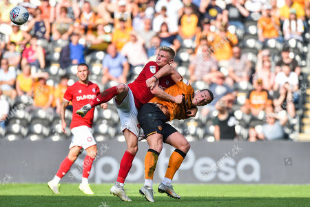 Stock Picture of Tom Eaves of Hull City and Taylor Moore of Bristol City tussle for the ball even before it arrives which summed up the physical battle on the pitch