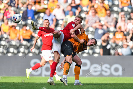 Tom Eaves of Hull City and Taylor Moore of Bristol City tussle for the ball even before it arrives which summed up the physical battle on the pitch