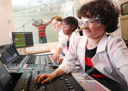 Nya Riley (8), Katie Downey (10), and Matti Kolirin (11) undertake research during the recording of the world's scientifically funniest fart as discovered in a new ground-breaking academic study commissioned by Beano.
