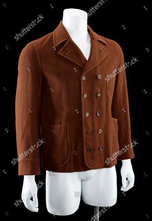 Stock Picture of Vito Corleone's (Robert De Niro) screen-matched brown peacoat from Francis Ford Coppola's Academy Award-winning gangster sequel The Godfather: Part II. Estimate: £10,000 - £15,000.