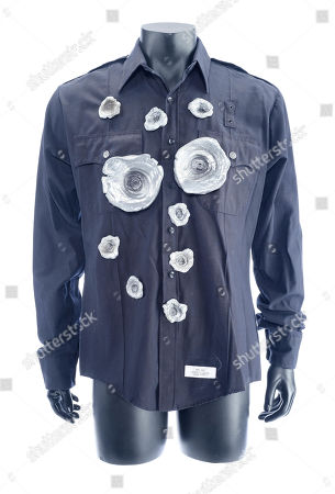 A T-1000 (Robert Patrick) bullet-hit zip-up LAPD shirt from James Cameron's sci-fi action sequel Terminator 2: Judgment Day. Estimate: £4000 - £6000.