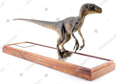 A Steven Spielberg ILM raptor model crew gift from his sci-fi action adventure film Jurassic Park. Estimate: £8000 - £10000.