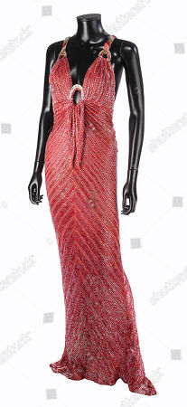 A beaded silver-and-red evening dress worn by Arlena Stuart Marshall (Diana Rigg) in Guy Hamilton's Agatha Christie adaptation Evil Under the Sun. Estimate: £500 - £700.