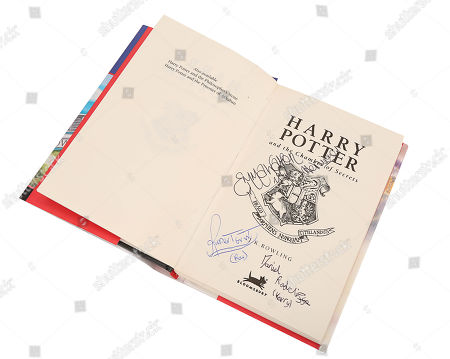 Stock Picture of A copy of Harry Potter and the Chamber of Secrets autographed by the three principal actors from Chris Columbus' film adaptation. Estimate: £600 - £800.