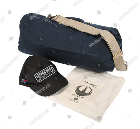 "A crew bag and ""Los Alamos Costume"" crew cap from Gareth Edwards' Rogue One: A Star Wars Story. Estimate: £200 - £300."