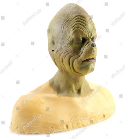 Stock Picture of A Grinch (Jim Carrey) makeup study head from Ron Howard's holiday comedy How The Grinch Stole Christmas. Estimate: £1000 - £1500.