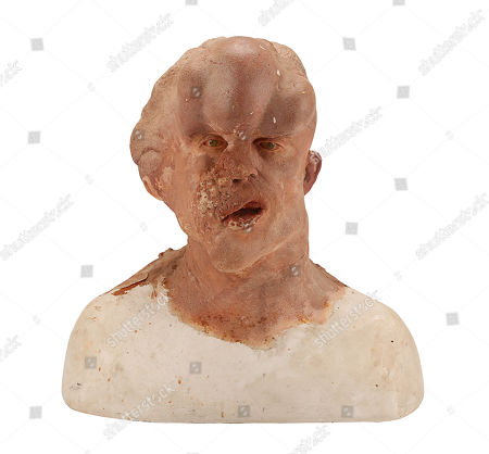Stock Picture of A makeup reference cast and archive photos used to create the prosthetics for John Merrick's (John Hurt) head, from the production of David Lynch's biopic drama The Elephant Man. Estimate: £5000 - £7000.