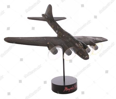 A model miniature flak-hit B-17 bomber from Michael Caton-Jones' World War II drama Memphis Belle. Estimate: £2000 - £3000.