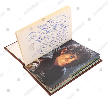 A notebook autographed by Peter Jackson and cast, promotional One Ring and weta bug from the making of Peter Jackson's adaptation of J. Estimate: £3000 - £5000.