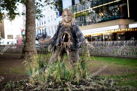 Stock Photo of Unsuspecting Londoners were pranked in Leicester Square today by terrifying scarecrow Harold, from Guillermo Del Toro produced Scary Stories to Tell in the Dark.