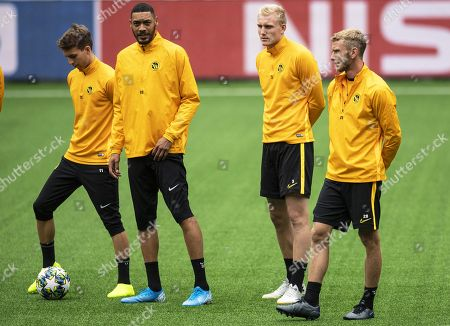 Young Boys players (L-R) Gianluca Gaudino, Guillaume Hoarau, Frederik Soerensen, and Fabian Lustenberger attend their team's training session in Bern, Switzerland, 20 August 2019. BSC Young Boys will face Red Star Belgrad in their UEFA Champions League playoff, first leg soccer match on 21 August 2019.