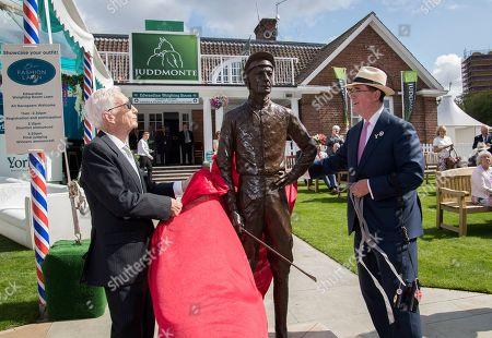Former jockey Lester Piggott unveils a statue of himself with Teddy Grimthorpe at York Racecourse
