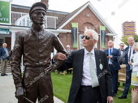 Stock Picture of Former jockey Lester Piggott unveils a statue of himself at York Racecourse
