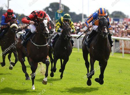 Valdermoro ridden by Tony Hamilton (left) narrowly beats Harpocrates ridden by Ryan Moore in the Tattersalls Acomb Stakes at York Racecourse