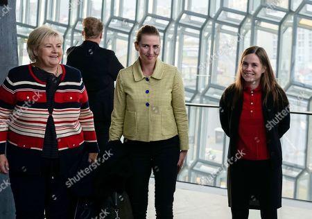 From left, Norway's Prime Minister Erna Solberg, Denmark's Prime Minister Mette Frederiksen and Prime Minister of Iceland Katrin Jakobsdottir arrive at Harpa Concert Hall in Reykjavik, ahead of the Nordic Prime Ministers meeting