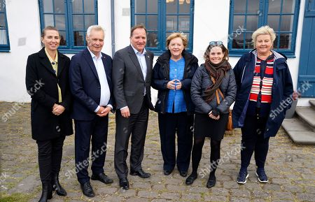 From left, Denmark's Prime Minister Mette Frederiksen, Finland's Prime Minister Antti Rinne, Sweden's Prime Minister Stefan Lofven, German Chancellor Angela Merkel, Prime Minister of Iceland Katrin Jakobsdottir and Norway's Prime Minister Erna Solberg arrive at Videy island near Reykjavik for a meeting on