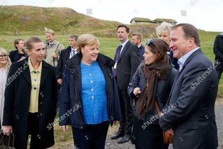 From left, Denmark's Prime Minister Mette Frederiksen, German Chancellor Angela Merkel, Prime Minister of Iceland Katrin Jakobsdottir and Sweden's Prime Minister Stefan Lofven arrive at Videy island near Reykjavik for a meeting on