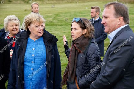 German Chancellor Angela Merkel, left, Prime Minister of Iceland Katrin Jakobsdottir and Sweden's Prime Minister Stefan Lofven arrive at Videy island near Reykjavik for a meeting on
