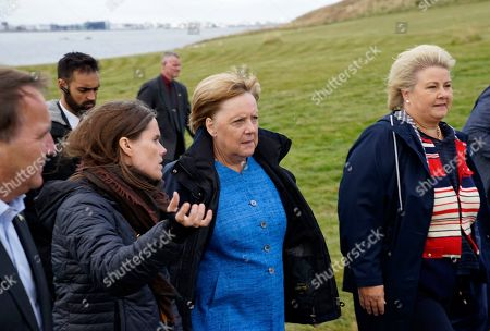 German Chancellor Angela Merkel, center, Prime Minister of Iceland Katrin Jakobsdottir, left, and Norway's Prime Minister Erna Solberg arrive at Videy island near Reykjavik for a meeting on