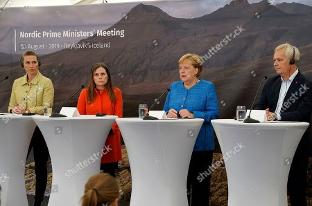 From left, Denmark's Prime Minister Mette Frederiksen, Iceland's Prime Minister Katrin Jakobsdottir, German Chancellor Angela Merkel and Finland's Prime Minister Antti Rinne speak to the media after a Nordic government leaders meeting, in Reykjavik, . The meeting in Iceland ended with the signature of a text on climate change involving both the public and private sectors