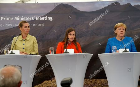 From left, Denmark's Prime Minister Mette Frederiksen, Iceland's Prime Minister Katrin Jakobsdottir and German Chancellor Angela Merkel speak to the media after a Nordic government leaders meeting, in Reykjavik, . The meeting in Iceland ended with the signature of a text on climate change involving both the public and private sectors