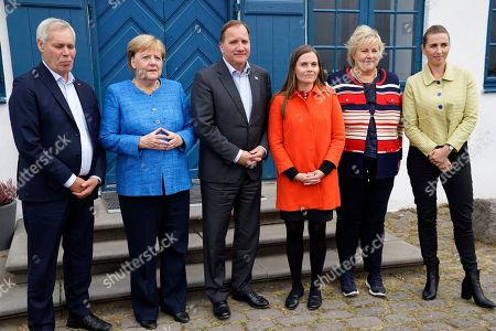 From left, Finland's Prime Minister Antti Rinne, German Chancellor Angela Merkel, Sweden's Prime Minister Stefan Lofven, Iceland's Prime Minister Katrin Jakobsdottir, Norway's Prime Minister Erna Solberg and Denmark's Prime Minister Mette Frederiksen pose for the media after a Nordic government leaders meeting, in Reykjavik, . The meeting in Iceland ended with the signature of a text on climate change involving both the public and private sectors