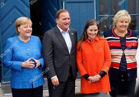 From left, German Chancellor Angela Merkel, Sweden's Prime Minister Stefan Lofven, Iceland's Prime Minister Katrin Jakobsdottir and Norway's Prime Minister Erna Solberg pose for the media after a Nordic government leaders meeting, in Reykjavik, . The meeting in Iceland ended with the signature of a text on climate change involving both the public and private sectors