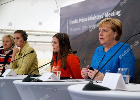 From left, Norway's Prime Minister Erna Solberg, Denmark's Prime Minister Mette Frederiksen, Iceland's Prime Minister Katrin Jakobsdottir and German Chancellor Angela Merkel speak to the media after a Nordic government leaders meeting, in Reykjavik, . The meeting in Iceland ended with the signature of a text on climate change involving both the public and private sectors