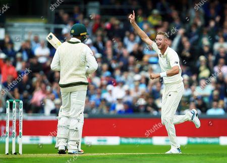 Stuart Broad of England celebrates taking the wicket of Usman Khawaja of Australia