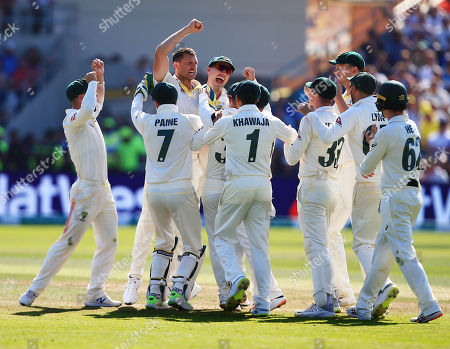 Stock Photo of James Pattinson of Australia celebrates taking the wicket of Stuart Broad of England with his team-mates after a review