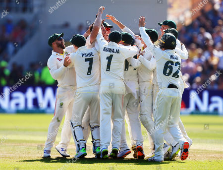 James Pattinson of Australia celebrates taking the wicket of Stuart Broad of England with his team-mates after a review