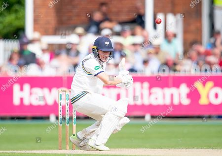 Yorkshire's Gary Ballance evades a short ball from Nottinghamshire's Paul Coughlin.
