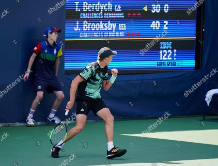 Stock Image of 18 year old Jenson Brooksby of USA celebrates in the first set during play against Tomas Berdych of Czech Republic