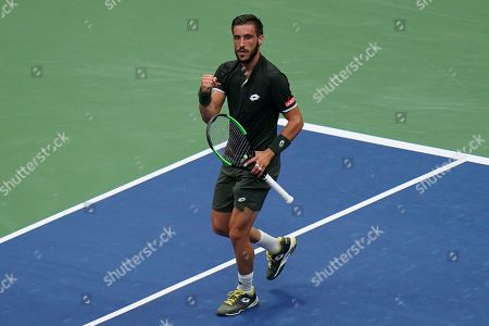 Damir Dzumhur of Bosnia and Herzegovina celebrates during play in the second round in the Arthur Ashe Stadium