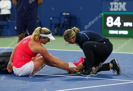 CoCo Vandeweghe of USA receives medical attention on court after falling during play in the first round