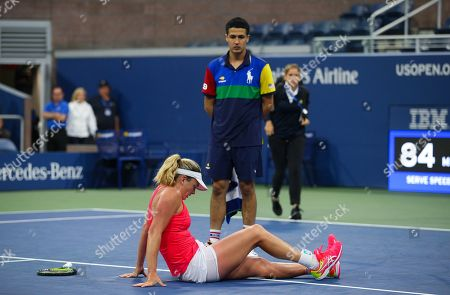 CoCo Vandeweghe of USA falls during play in the first round