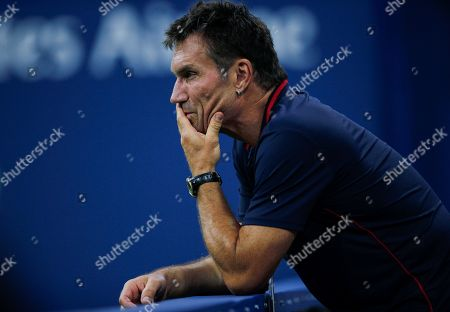 Pat Cash, coach of CoCo Vandeweghe of USA, looks on after CoCo Vandeweghe falls during play in the first round