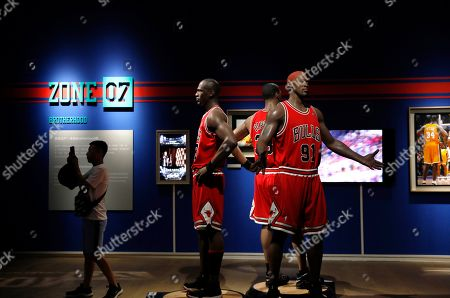 Stock Image of Life-size wax figures of US basketball players Michael Jordan, Scottie Pippen and Dennis Rodman are exhibited at the NBA exhibition in Beijing, China, 20 August 2019. The NBA exhibition 'Unstoppable Beijing' showcases the history of the league since 1946 through interactive exhibits, video, and imagery. It is held ahead of the FIBA Basketball World Cup in China from 31 August to 15 September 2019.
