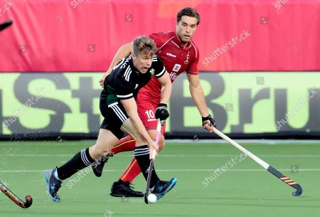 Wales' Rhodri Furlong, left, vies for the ball against Belgium's Cedric Charlier during a men's European Championships field hockey match between the Belgium and Wales at the Wilrijkse Plein, Antwerp, Belgium