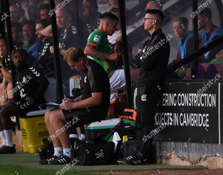 Adam Hammill of Scunthorpe United kicks the bench after being substituted