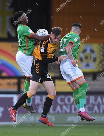 Paul Lewis of Cambridge United collides with Kgosi Ntlhe of Scunthorpe United and Adam Hammill of Scunthorpe United