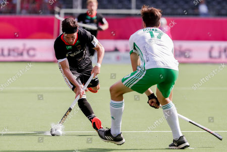 Martin Zwicker of Germany (L) and Sean Murray of Ireland in action during the EuroHockey 2019 men's match between Ireland and Germany in Antwerp, Belgium, 20 August 2019.
