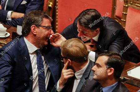 Stock Photo of Italian Premier Giuseppe Conte talks to Giancarlo Giorgietti as he addresses the Senate in Rome, . The political showdown on Tuesday was triggered two weeks ago by hard-line Interior Minister Matteo Salvini, known across Europe for his tough stance against migrants, when he pulled the plug on the shaky populist coalition forged only 14 months earlier between his right-wing League and the anti-establishment 5-Star Movement