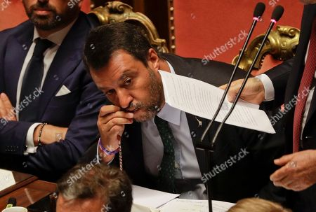 Italian Deputy-Premier Matteo Salvini kisses a rosary as Premier Giuseppe Conte addresses the Senate in Rome, . The political showdown on Tuesday was triggered two weeks ago by hard-line Interior Minister Matteo Salvini, known across Europe for his tough stance against migrants, when he pulled the plug on the shaky populist coalition forged only 14 months earlier between his right-wing League and the anti-establishment 5-Star Movement