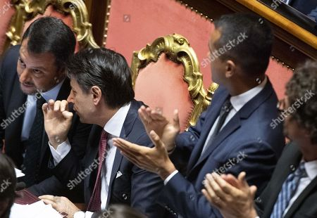 Italian Prime Minister Giuseppe Conte (C) is flanked by Interior Minister Matteo Salvini (L); Welfare Minister Luigi Di Maio (2R) and Transport Minister Danilo Toninelli (R) at the Senate in Rome, Italy, 20 August 2019. Conte in his address to the senate called bringing about the government crisis irresponsible. Deputy Premier and Interior Minister Matteo Salvini and his party League pulled out from government and caused a political crisis a week ago. Conte said that the government has come to an end and that he would resign.