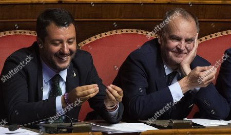 Italian Deputy Premier and Interior Minister Matteo Salvini (L) and League Senator Roberto Calderoli smile during Italian Former Prime Minister Matteo Renzi's speech at the Senate, Rome, Italy, 20 August 2019. Italian Premier Giuseppe Conte said that the government has come to an end and that he would resign.