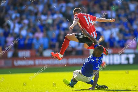 24th August 2019 , Bramall Lane, Sheffield, England; Premier League Football, Sheffield United vs Leicester City ; Wes Morgan (5) of Leicester City tackles Ravel Morrison (14) of Sheffield United 