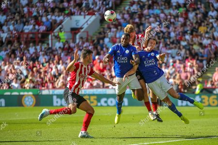 24th August 2019 , Bramall Lane, Sheffield, England; Premier League Football, Sheffield United vs Leicester City ; , Wes Morgan and Jonny Evans (6) of Leicester City compete with Oliver McBurnie (9) of Sheffield United for the crossed ball