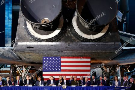 Vice President Mike Pence, center, leads the sixth meeting of the National Space Council beneath NASA's Space Shuttle Discovery at the National Air and Space Museum's Steven F. Udvar-Hazy Center, in Chantilly, Va